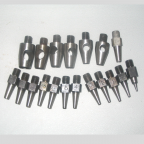 Set of 8 Large Interchangeable Round Punch Bits.